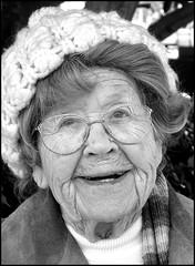ninety-two or ninety-three (greenthumb_38) Tags: blackandwhite bw woman smile glasses blackwhite iso400 kind elderly duotone wrinkles processed knitcap gentle jeffreybass canong11