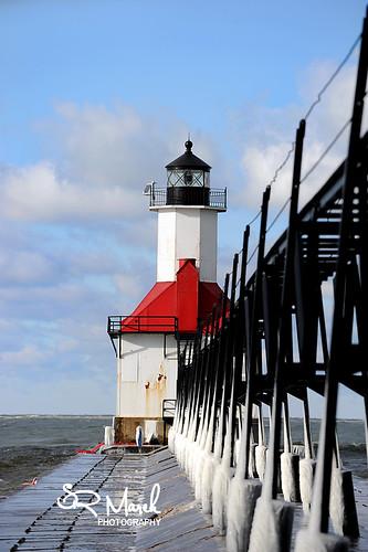 lighthouse frozen pier