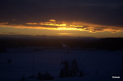 The First Eve of New Year (Rebeak) Tags: trees houses sunset sky sun snow mountains cars alaska clouds nikon streetlights valley fields oranges roads yellows stoplights taillights electricpole fencerows abovethevalley rebeak manywintersalasakashelly