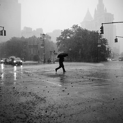 Manhattan is sinking like a rock, and Romeo runs, runs, runs... (Airicsson) Tags: street new york city nyc summer urban blackandwhite bw usa white ny storm man black rain weather umbrella island lumix us alone cityhall walk manhattan extreme apocalypse broadway running panasonic financialdistrict rainy blackdiamond 2010 streetshot lx3