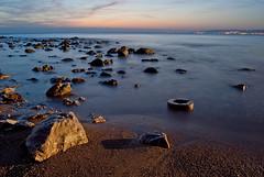 Il posacenere (the_lighter) Tags: sunset sea roma nikon long exposure tramonto mare colours stones sassi lazio santasevera scogli crepuscolo orizzonte d60 posacenere civitavecchia lucette striature