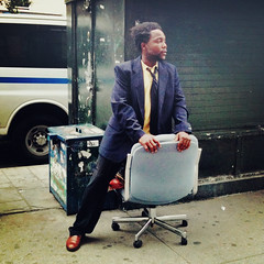 """The Sidewalk Businessman"" (antonkawasaki) Tags: portrait candid streetphotography squareformat iphone4 iphoneography antonkawasaki crossprocessapp thesidewalkbusinessman africanamericanmaninsuitandtiehalfsittingonofficechairinthemiddleofasidewalk lookingtomakesomedeals"