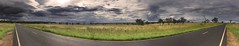 The Start Of A Stormy Afternoon (rhyspope) Tags: road street new summer sky panorama storm tree green grass wales clouds rural photoshop canon dark landscape highway track bend path pano south horizon central meadow australia nsw thunderstorm aussie plains curve bitumen tar distort paddock cs3 500d dunedoo cloudsstormssunsetssunrises rhyspope