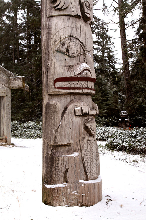 snow and totem in front of Chief Son-i-Hat Whale House, Kasaan, Alaska