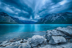 A beautiful, cloudy morning at Lake Minnewanka (RichHaig) Tags: banffnationalpark lakeminnewanka lake landscape banff nikonnikkor1424mmf28 gitzotripod alberta mountains clouds canada richhaig water nikond800 rocks