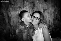 Mother's heart (Aurorasogna Mila) Tags: bacio kiss mamma mother mom madre figlio son child kid bam bino bimbo bambino bianco nero black white bw portraits portrait ritratto primopiano glass glasses occhiali smile sorriso reflex sony alpha290 aurorasogna flickr