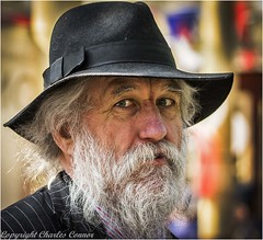 A face in the crowd (cconnor124) Tags: streetportraits portraits beards faces hats white black wrinkles aged eyes canon100400lens canon760d canoneos people peoplephotography