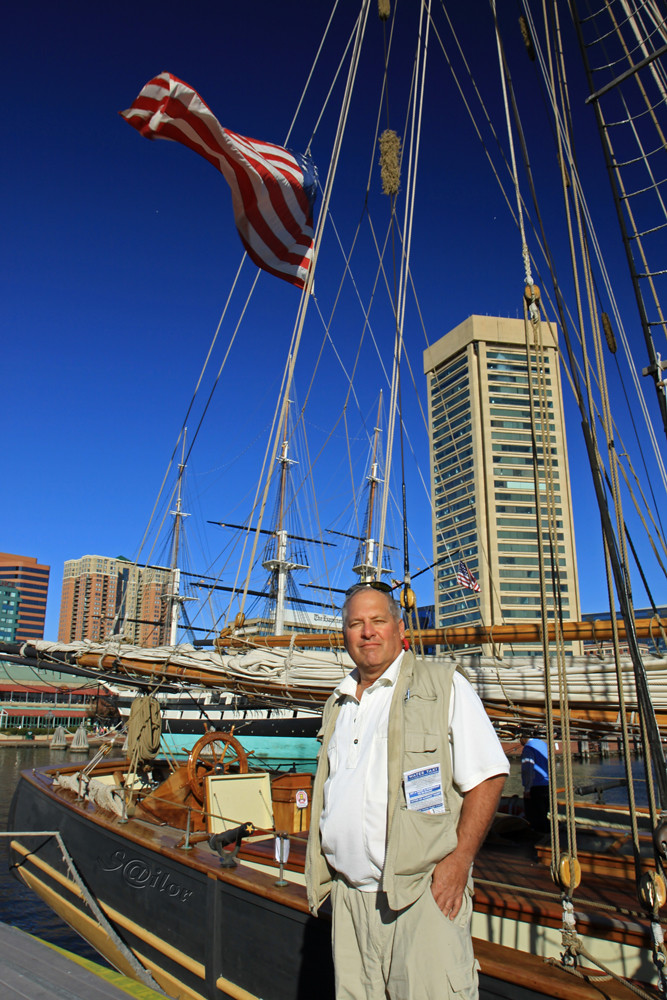 "Jim. Another Sailor and Friend Posing in front of ""Pride of Baltimore II"""