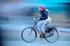 Amsterdam beweegt (FaceMePLS) Tags: woman girl amsterdam bicycle boots nederland thenetherlands streetphotography jeans denim vrouw meisje fiets omafiets tweewieler laarzen straatfotografie damesfiets facemepls schoudertas nikond300 rodemuts