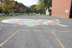 IMG_1063 (Slow Little Photo) Tags: wood school color brick cars playground sign parkinglot colorful map painted shed crop geography edit foreground
