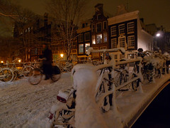Biking on the snowy and slippery bridges in Amsterdam (Bn) Tags: city bridge winter snow sinterklaas amsterdam bike bicycle canal nightshot letitsnow sled topf100 sneeuwpoppen brigde sleds gezellig jordaan winterwonderland sneeuwpret sledge tms antonpieck bloemgracht sneeuwvlokken winterscene amsterdambynight tellmeastory 100faves kruimeltje winterinamsterdam derdeleliedwarsstraat spiegelglad prachtigamsterdam oudemeester dichtesneeuw amsterdamonregeld winterdocumentary amsterdamgeniet koplampenindesneeuw geenwinterbanden amsterdamindesneeuw mooiesneeuwplaatjes vallendesneeuwvlokken sleetjerijdenvanafdebrug stadvastdoorzwaresneeuwval sneeuwvalindejordaan heavysnowfallhitsamsterdam autoopdegrachtenindesneeuw sneeuwindejordaan iceageinamsterdam winterin2010 besneeuwdestad sneeuwindeavond pittoreskewinterplaatje metdesleedooramsterdamin2010 kidsonasled sleetjerijdenindejordaan kinderengenietenvandesneeuw hollandsschilderij bloemgrachtbynight wintersfeerplaat winterscenebyantonpieck