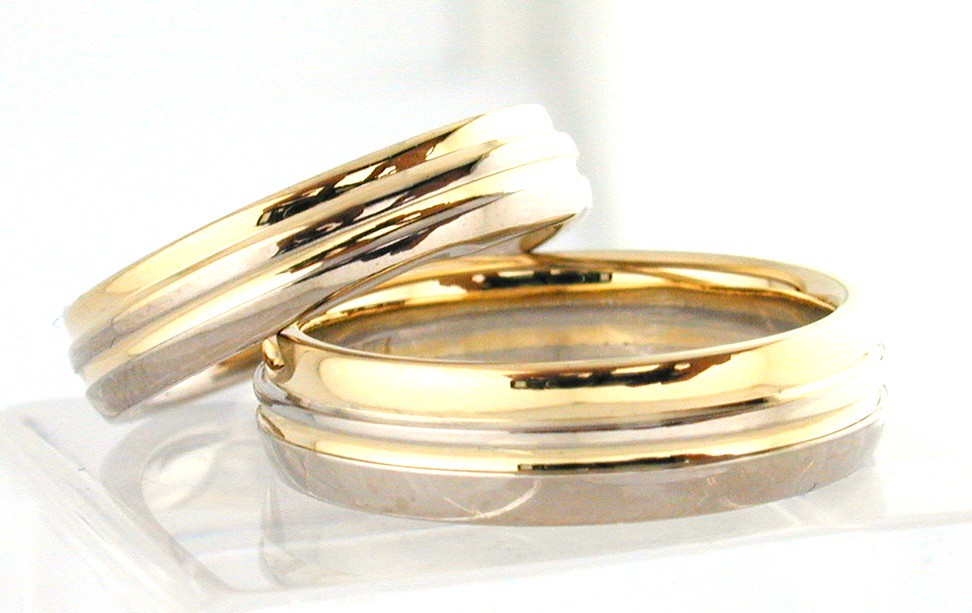 Elegantly carved His and Hers Matching Wedding Bands