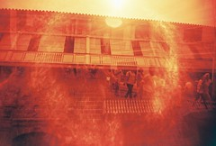 Ember Glare II (lovelygrain) Tags: circle walking glare fuji slim 400 ember ultrawide vivitar intramuros xtra redscale