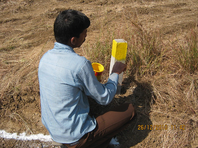 Painting the boundary stones of an individual plot - Majestic  NA Bungalow Plots:  at Kanhe Phata - near Vadgaon - Talegaon, walking distance from Kanhe Railway Station, on Old Mumbai Pune Highway (NH 4)