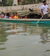 Follow the Leader (Jo Mari Montesa) Tags: ocean wood travel sea house fish net nature water rural canon river asian photography eos boat photo wooden fishing kiss asia village fishermen philippines full housing catch hd province asean x4 fishingvillage digita bangka fishernan 550d binuangan bulacanphilippines baklad followtheleaderriversofobandoobando