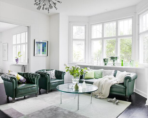 family-room-with-green-chairs-and-sofa