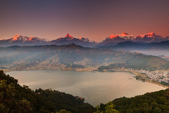 Happy New Year 2011 (Helminadia Ranford) Tags: nepal sunset mountain lake landscape pagoda range pokhara annapurna macchupuchare