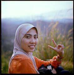Ella - Peace! (mankamen et ella) Tags: woman 120 6x6 zeiss square t kodak c muslim hijab cm hasselblad carl malaysia wife medium format 500 malaysian portra milf malay fju bukit planar 80mm rsm 400vc broga filmforever manilovefilm randomshotmalaysia filmjunkiesunite filemmalaya