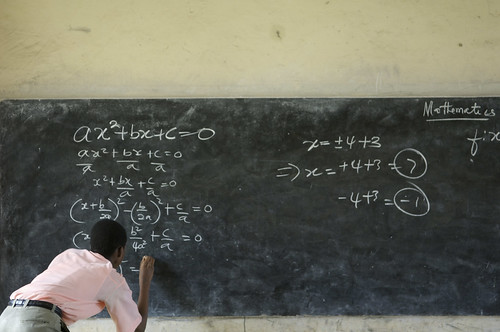 A student solves a mathematics equation by World Bank Photo Collection, on Flickr