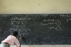 A student solves a mathematics equation at the Mfantsipim Boys School in Cape Coast (World Bank Photo Collection) Tags: landscape student education classroom teacher ghana math mathematics teaching chalkboard maths development blackboard worldbank lessons algebra capecoast secondaryeducation