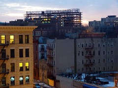 Building Up-Sun Up Harlem (Roblawol) Tags: nyc newyorkcity windows winter building yellow sunrise subway dawn lights construction apartment harlem january mta sunup fireescapes 125thstreet manhattanville subwayplatform 2011 january4 010411