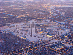MSP Airport Aerial (MSPdude) Tags: bridge snow cemetery minnesota canon river mississippi airport dusk stpaul minneapolis msp terminal aerial powershot national freeway bloomington mendota runway overview interchange stp fortsnelling taxiway richfield i494 holmanfield s5is mn77 mn5 mn55