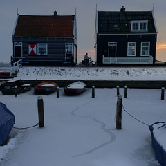 Characteristic wooden houses of Marken (Bn) Tags: winter sunset lake snow storm haven cold holland green tourism ice netherlands dutch bike boats harbor frozen twilight fishing zonsondergang community village bevroren district painted iceskating sneeuw skating tourists marker isolation dijk peninsula dike marken mounds stilts ijsselmeer noordholland waterland bycicle schaatsen 1916 darkgreen zuiderzee dikes bootjes woodenhouses havenbuurt markermeer northholland huisjes gouwzee mereke waternoodsramp gouwsea formedisland