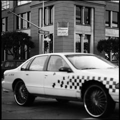 San Francisco (Mateusz Czudowski) Tags: sf street urban bw mars white black zeiss oakland bay march big san francisco kodak trix x hasselblad area pimp tri rims sh sort 2009 400asa cruizer 400iso pimpmobile 500cm 150mm hvitt shv