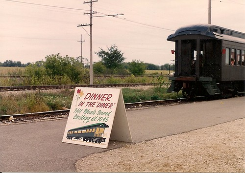 "The ""Dinner In The Diner"" sign and passenger train. The Illinois Railway Museum. Union Illinois USA. 1995. by Eddie from Chicago"
