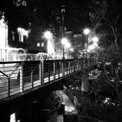 San Antonio (Peter Gutierrez) Tags: street city bridge light people urban bw usa white black streets building film public rio architecture night del america buildings river square lights evening noche town us photo san iron downtown texas nocturnal time nacht pavement walk steel tx centre united down center architectural sidewalk paseo peter nighttime american gutierrez americana states antonio nocturne notte riverwalk texan bexar bejar nui antonian petergutierrez antonians
