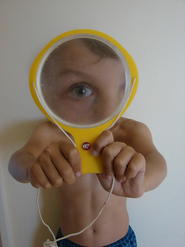Boy with Yellow Magnifying Glass by barbourians