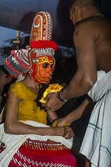 Getting Ready for Theyyam (Anoop Negi) Tags: theyyam kerala india kannur dance ancient old getting ready red head gear face painting turmeric powder vegetable dyes photo photography anoop negi ezee123