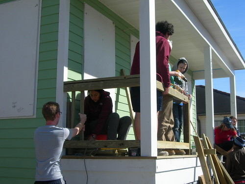 Students work on the banister