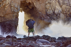 The Photographer - Jared Atencio, Pfeiffer State Beach, California (PatrickSmithPhotography) Tags: california sunset portrait usa seascape seaweed water rock umbrella landscape crazy sandstone photographer unitedstates wave brolly pfeiffer loony tafoni saltspray
