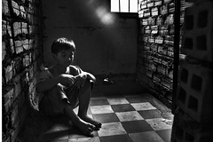 S21, Tuol Sleng Prison, Phnom Penh - Prisoner 210 (Mio Cade) Tags: world boy dark rouge kid cambodia alone khmer spirit room dream cell prison vision soul torture murder mission 1978 caught trap limbo prisoner s21 sleng tuol visna