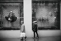 The subtle art of accessorising (Ian Brumpton) Tags: street england blackandwhite bw blancoynegro blackwhite rainyday noiretblanc pavement candid citylife ostrich explore londres citystreets mayfair biancoenero louisvuitton accessorize ilpleut sidewalkstories agranddayout explored accessorising londonstreetphotography lifeinslowmotion designerchic scattidistrada neroameta aspotofrain aimlessstrolling londonatlarge ahandbagtoofar