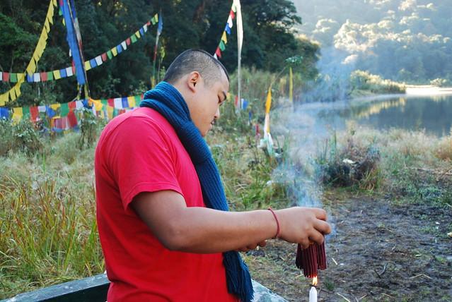 lighting incense at Khecheopalri Lake