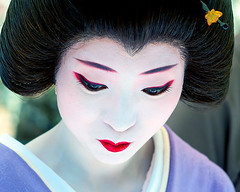 Umeha at Baika Sai, Kyoto (richard thomson) Tags: red portrait white face festival japan still kyoto lips maiko geiko geisha teaceremony ume nodate baikasai umeha plumblossomfestival