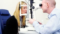 Denise Van Outen being checked after laser eye surgery by Mr David Allamby