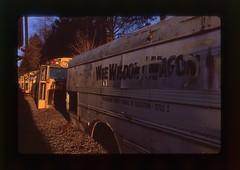 The Wee Wisdom Wagon (EvenShift///3) Tags: sunset film yellow analog yard wagon junk rust peeling shadows grain wee junkyard wisdom schoolbus