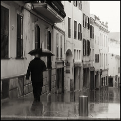 the man who loved the rain (joanpetrus) Tags: street winter light bw man black reflection 6x6 rain weather composition umbrella walking outside outdoors blackwhite calle lluvia europe soft moments solitude alone peace pavement joy memories creative dream atmosphere happiness nb bn explore human serenity promenade capture oniric cinematic rue blanc carrer timeless negre happydays narrative memoria 1x1 blackdiamond nostalgy streetshot febrer mojado hivern pluja limux 500x500 bwd bwdreams incoloro artlibre aplusphoto ploure mollat purestreet joanpetrus damnedpoets dmcgf1 dmcgf1c