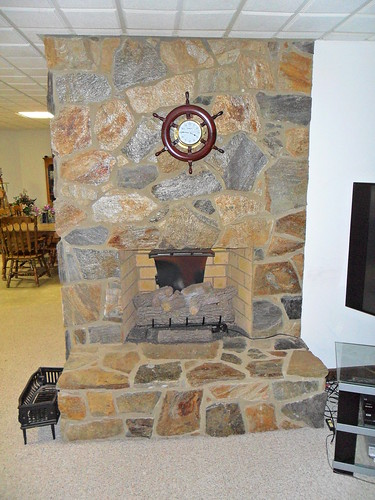 stone fireplace built with stone veneer inside a private home