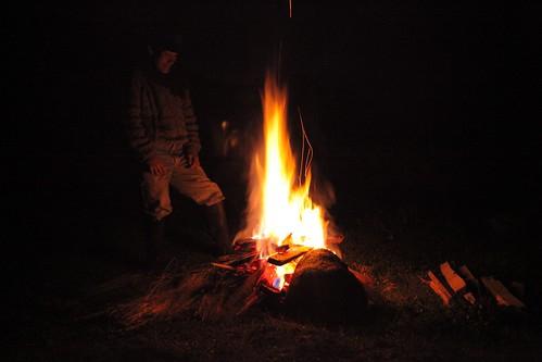 A fire roars.