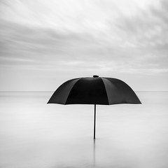 Lone umbrella in the sea (Kees Smans) Tags: longexposure sea sky blackandwhite bw cloud seascape reflection nature water netherlands umbrella square outdoors photography day open fineart tranquility zeeland nopeople fantasy ideas protection gettyimages absence longtimeexposure royaltyfree daytimelongexposure horizonoverwater niksoftware blackandwhitefineart bwnd110 dfine20 theflickrcollection keessmans blackandwhitelongtimeexposure wwwbwfineartcom silverefexpro2 ©2011keessmans 001kspgetty