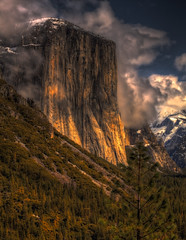El Capitan Rising from the Dark ( Yosemite ) (Raj R Rami) Tags: california trees sunlight storm mountains clouds dramatic yosemite blueskies elcapitan yosemitevalley clearingstorm canon70200f28lll