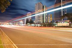 broadbeach (Pawel Papis Photography) Tags: road street city blue light sky urban cloud motion blur building bus tree texture lamp beautiful shop architecture modern night drive evening town movement glow cityscape traffic dynamic dusk district transport dramatic australia illuminated line business trail busy rush congestion goldcoast broadbeach