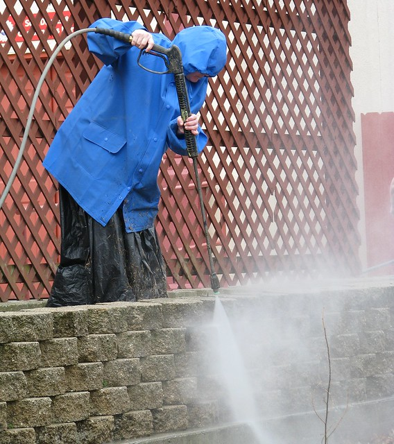 Pressure washing the park prior to season opening.
