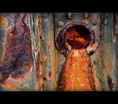 medway marmalade 1 (pete ware) Tags: orange wet st metal se rust iron rivets hole decay crap orifice drainhole rivermedway nikond90 peteware