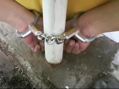 Shackling prisoner for transport (asiancuffs) Tags: handcuffs handcuffed arrest arrested prisoner inmate shackles