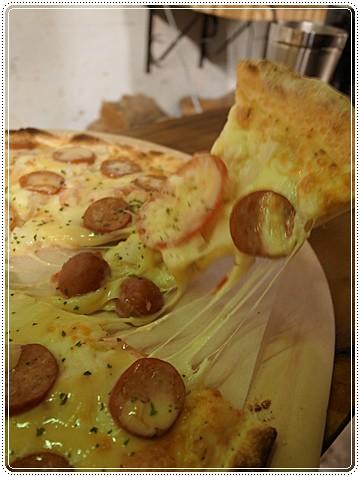 會牽絲的披薩